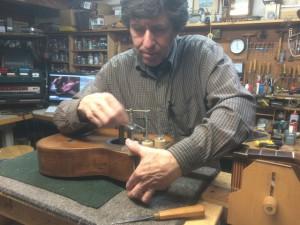 Arnie Gamble restoring a parlor guitar.