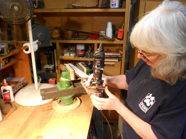 Erin routing the head stock for the circle.