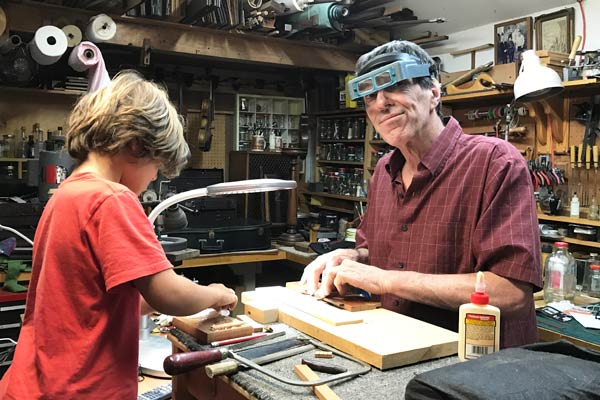 Making the bridge for a Guitalele with my new assistant.